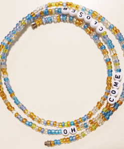 blue clear gold waist beads with text