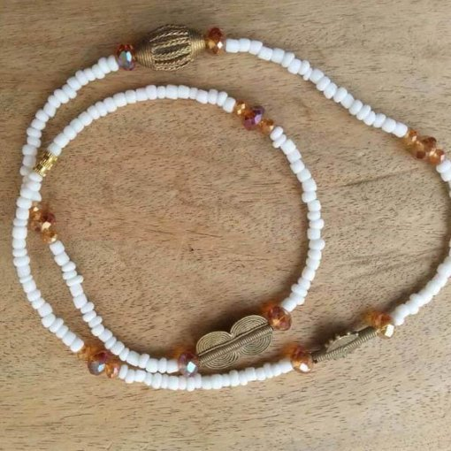 white with brass charms waist beads