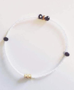 white beads with gold and black crystals